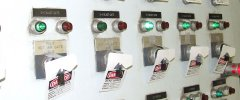 Tagout of electrical switches in a control room warns employees not to start equipment.